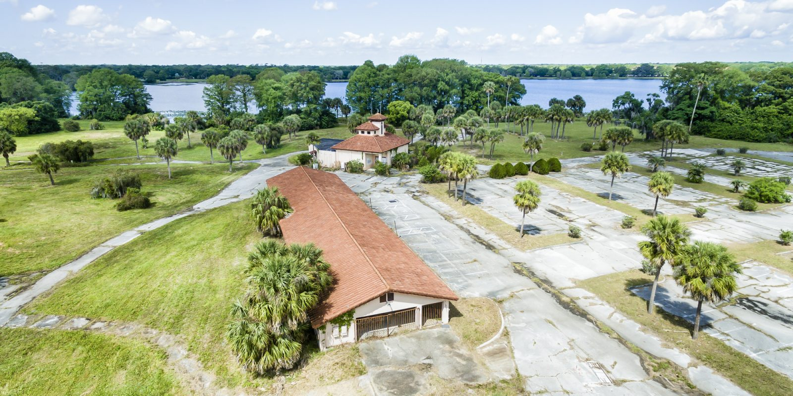 Current state of the former Lake Orlando Golf Club abandoned clubhouse immediately post acquisition with Lake Orlando in the background.